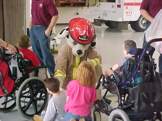 Sparky Visiting with Children